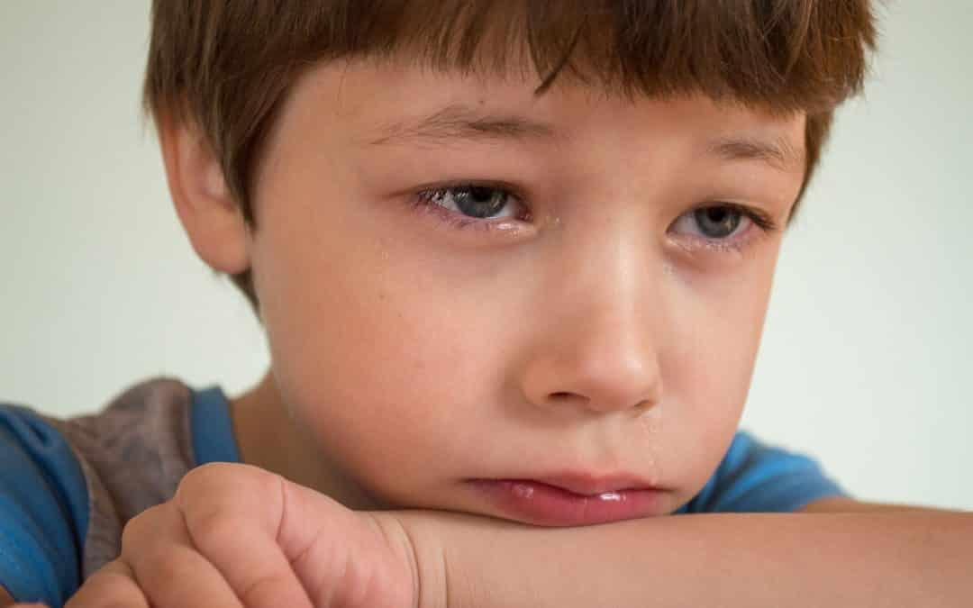 Harcèlement scolaire, un enfant triste